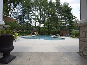 landscaped theater with seating, backyard playground and pool
