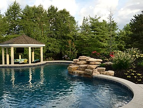beautifully lanscaped garden areas surrounding pool and waterside gazebo
