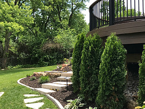 manicured lawn with beautiful rock walkways