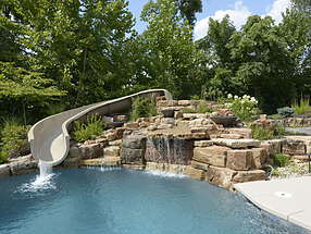 waterfall and waterslide lend serenity to this relaxing refuge
