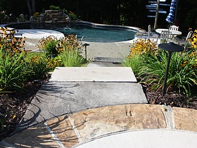 sun-warmed stone and lively water features in sunny seclusion