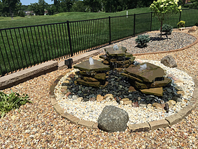 landscape design, hardscape, st. louis landscape, water feature, fountain, flagstone, beach pebbles, granite