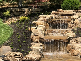 landscape design, hardscape, st. louis landscape, pondless waterfall, limestone boulders, sedum, ground cover