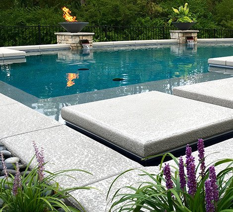 exclusive backyard escape featuring landscaping, water features and lighting
